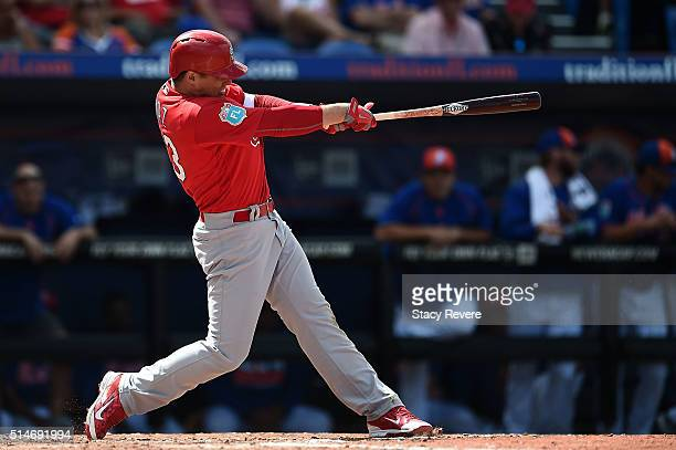 Aledmys Diaz of the St Louis Cardinals swings at a pitch during a spring training game against the New York Mets at Tradition Field on March 10 2016...