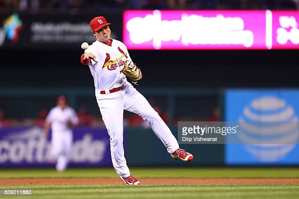 Aledmys Diaz of the St Louis Cardinals throws a runner out against the Washington Nationals in the third inning at Busch Stadium on April 29 2016 in...