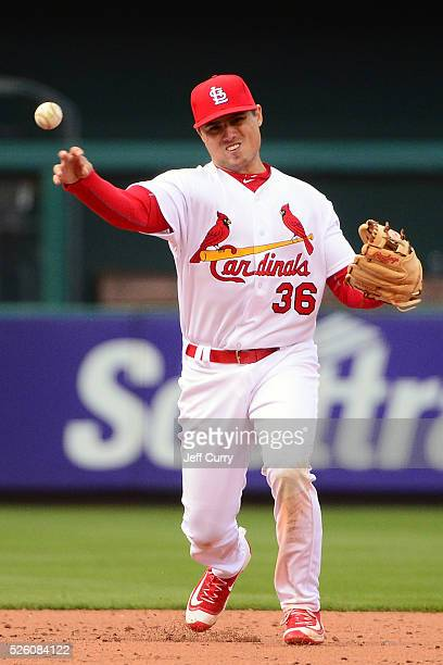 Aledmys Diaz of the St Louis Cardinals throws after fielding a ground ball against the Milwaukee Brewers during the home opener at Busch Stadium on...