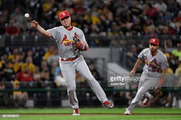 Aledmys Diaz of the St Louis Cardinals throws to first base to force out Max Moroff of the Pittsburgh Pirates in the seventh inning during the game...