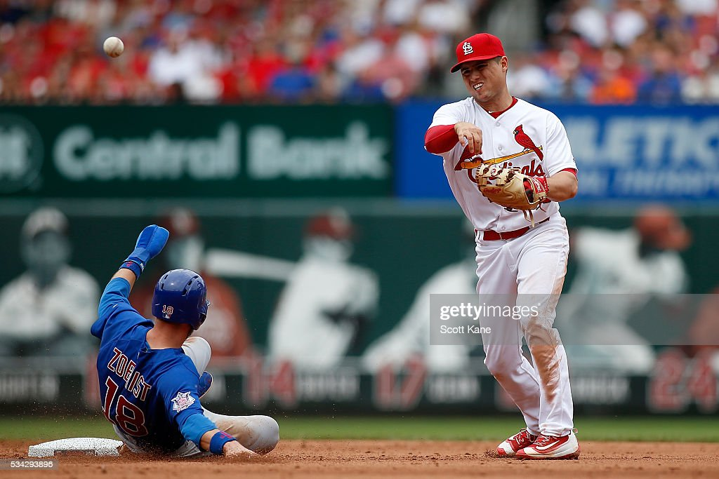 Aledmys Diaz #36 of the St. Louis Cardinals turns a double play over <a gi-track='captionPersonalityLinkClicked' href=/galleries/search?phrase=Ben+Zobrist&family=editorial&specificpeople=2120037 ng-click='$event.stopPropagation()'>Ben Zobrist</a> #18 of the Chicago Cubs during the fifth inning of a baseball game at Busch Stadium on May 25, 2016 in St. Louis, Missouri.