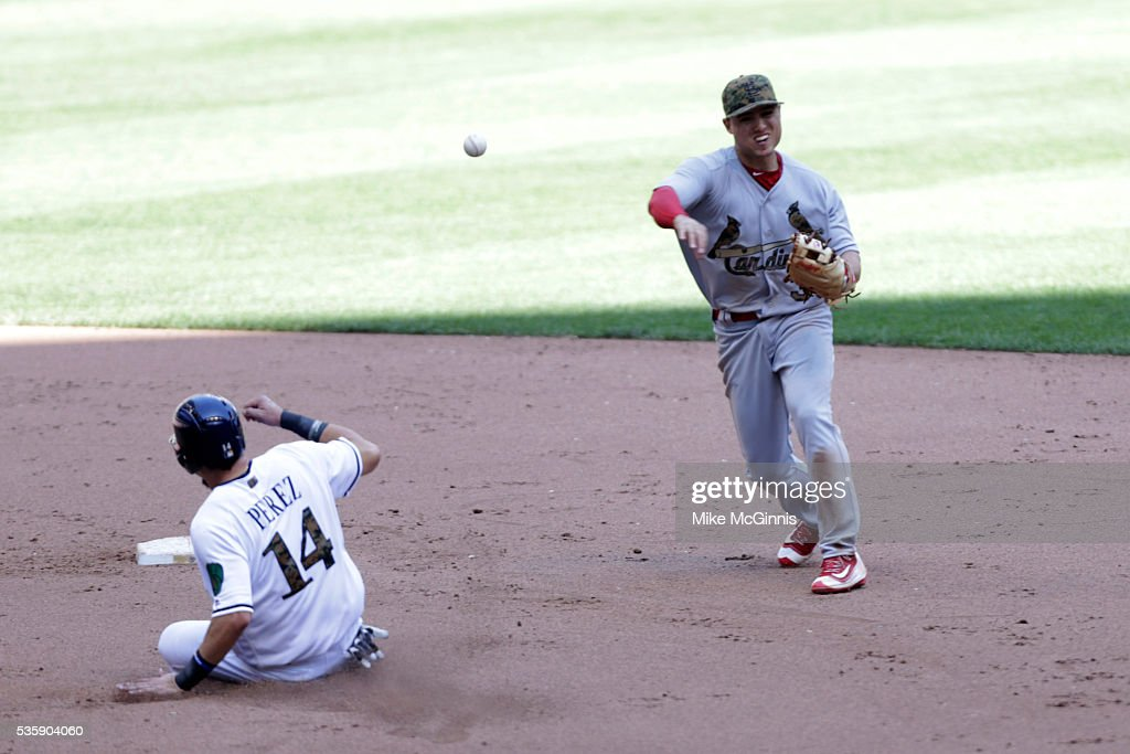 Aledmys Diaz #36 of the St. Louis Cardinals turns the double play as Hernan Perez #14 or the Milwaukee Brewers slides into second base during the seventh inning against the Milwaukee Brewers at Miller Park on May 30, 2016 in Milwaukee, Wisconsin.