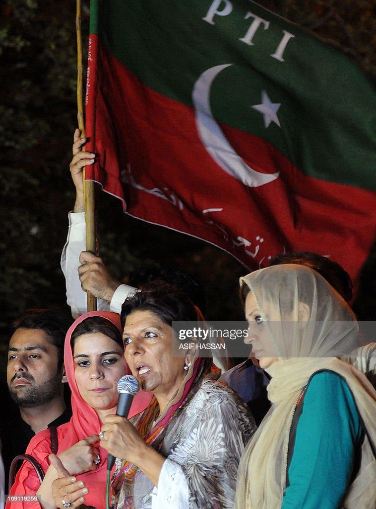 Aleema (C), sister of Imran Khan, the head of Pakistan Tehreek-e-Insaf (PTI) party, addresses the supporters in a protest against the killing of Sindh provincial party leader Zohra Hussain, in Karachi on May 20, 2013. The party of former Pakistani cricket hero Imran Khan secured victory in a repeat election held in one constituency of violence-plagued Karachi, election officials said Monday. Voting was held under tight security in 43 polling stations on May 19, a day after a senior official of Khan's Tehreek-e-Insaaf (PTI) party was shot dead outside her home in the city.