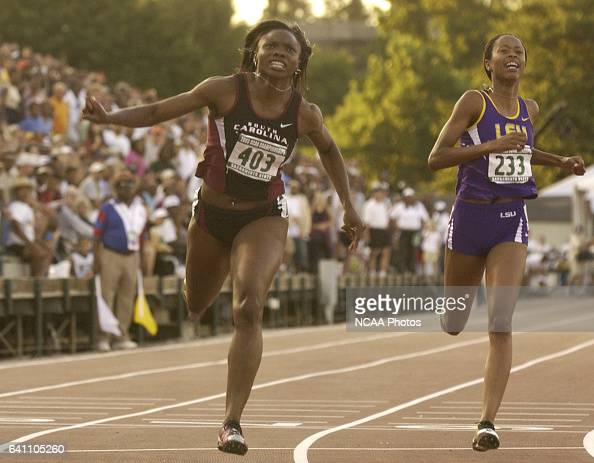 Aleen Bailey of South Carolina and Muna Lee of LSU cross the finish line of the Women's 200 Meter race during the Division 1 Men's and Women's...