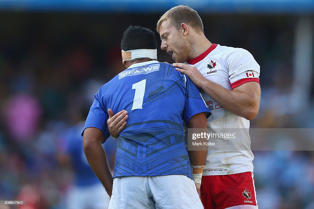 Alefosio Tapili of Samoa is embraced by Harry Jones of Canada at fulltime during the 2016 Sydney Sevens bowl final match between Canada and Samoa at Allianz Stadium on February 7, 2016 in Sydney, Australia.