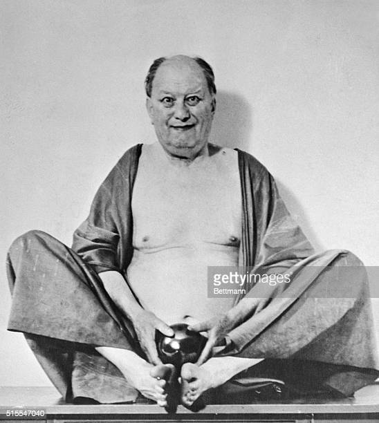 Aleister Crowley is shown as Fo Hi the Chinese God of laughter and money