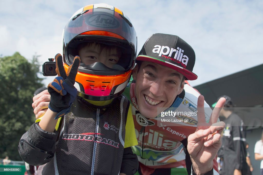 Aleix Espargaro of Spain and Aprilia Racing Team Gresini poses his teammate for this pre-event race during the pre-event 'The mini-battle between the MotoGP riders and children with electric mini bikes at Mobi Park at Motegi' ahead of the MotoGP of Japan at Twin Ring Motegi on October 12, 2017 in Motegi, Japan.