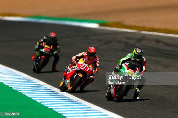 Aleix Espargaro of Spain and Aprilia Racing Team Gresini rides ahead of Marc Marquez of Spain and the Repsol Honda Team and Jonas Folger of Germany...