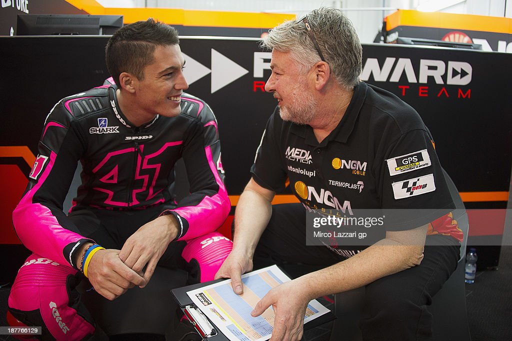<a gi-track='captionPersonalityLinkClicked' href=/galleries/search?phrase=Aleix+Espargaro&family=editorial&specificpeople=5550804 ng-click='$event.stopPropagation()'>Aleix Espargaro</a> of Spain and NGM Mobile Forward Racing looks on in box during the MotoGP Tests in Valencia - Day 2 at Ricardo Tormo Circuit on November 12, 2013 in Valencia, Spain.