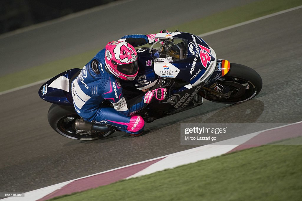 <a gi-track='captionPersonalityLinkClicked' href=/galleries/search?phrase=Aleix+Espargaro&family=editorial&specificpeople=5550804 ng-click='$event.stopPropagation()'>Aleix Espargaro</a> of Spain and Power Electronics Aspar rounds the bend during the MotoGp of Qatar - Free Practice at Losail Circuit on April 5, 2013 in Doha, Qatar.