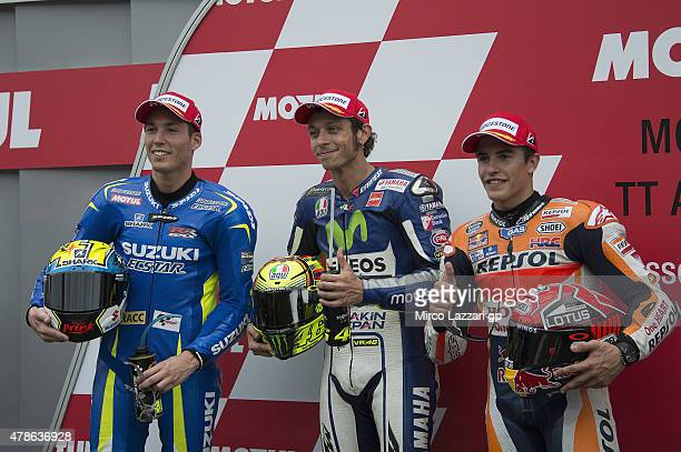 Aleix Espargaro of Spain and Team Suzuki MotoGP Valentino Rossi of Italy and Movistar Yamaha MotoGP and Marc Marquez of Spain and Repsol Honda Team...