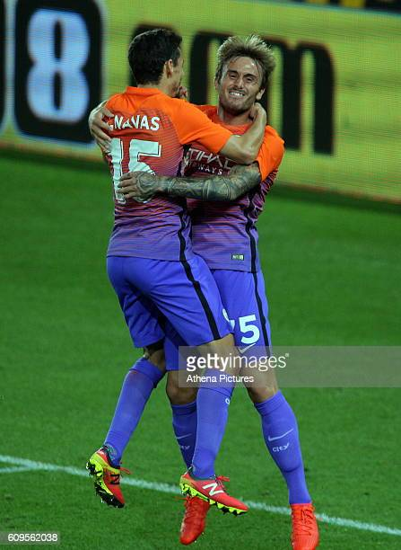 Aleix Garcia of Manchester City celebrates his goal with team mate Jesus Navas during the EFL Cup Third Round match between Swansea City and...