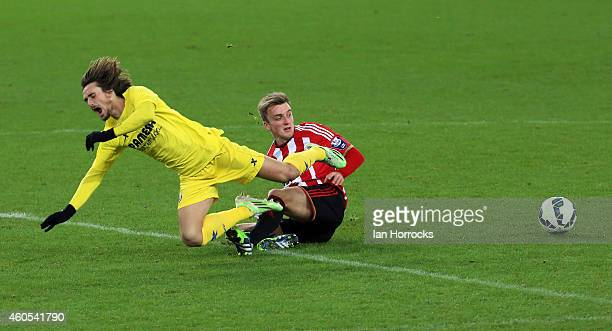 Aleix Garcia of Villarreal is brought down by Martin Smith of Sunderland during the Premier League International Cup match between Sunderland U21 and...