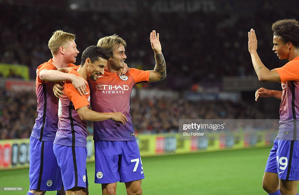 Aleix Garcia Serrano of Manchester City celebrates scoing his sides second goal with team mates during the EFL Cup Third Round match between Swansea City and Manchester City at the Liberty Stadium on September 21, 2016 in Swansea, Wales.