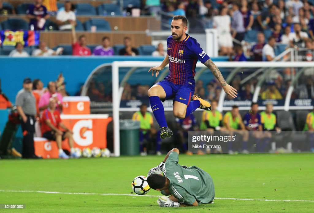 Aleix Vidal #22 of Barcelona jumps over Keylor Navas #1 of Real Madrid in the second half during their International Champions Cup 2017 match at Hard Rock Stadium on July 29, 2017 in Miami Gardens, Florida.