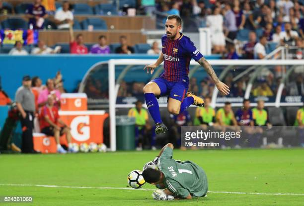Aleix Vidal of Barcelona jumps over Keylor Navas of Real Madrid in the second half during their International Champions Cup 2017 match at Hard Rock...