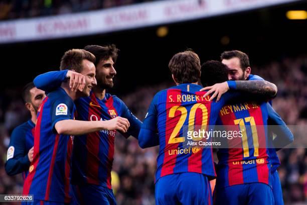 Aleix Vidal of FC Barcelona celebrates with his teammates Ivan Rakitic Andre Gomes Sergi Roberto and Neymar Santos Jr after scoring his team's third...