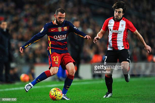 Aleix Vidal of FC Barcelona competes for the ball with Benat Etxebarria of Athletic Club during the La Liga match between FC Barcelona and Athletic...