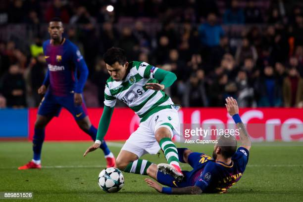 Aleix Vidal of FC Barcelona tackles Marcos Acuna of Sporting CP during the UEFA Champions League group D match between FC Barcelona and Sporting CP...
