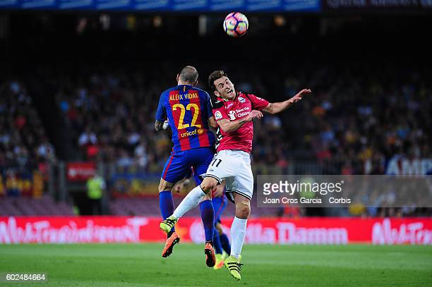 Aleix vidal of FCBarcelona fighting for the ball with Ibai Gómez from Deportivo alavés during the Spanish League match between FC Barcelona vs...