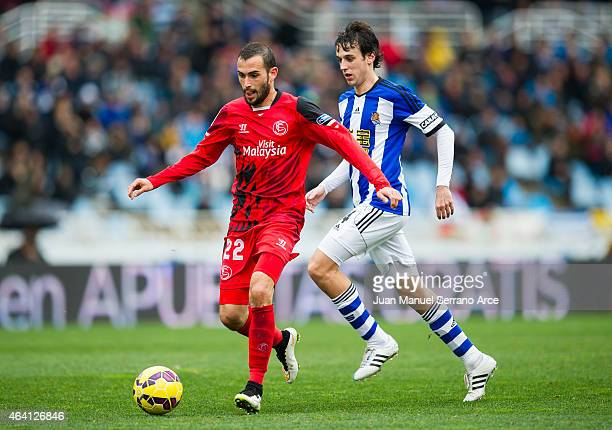 Aleix Vidal of Sevilla FC duels for the ball withÊRuben Pardo of Real Sociedad during the La Liga match between Real Sociedad and Sevilla FC at...