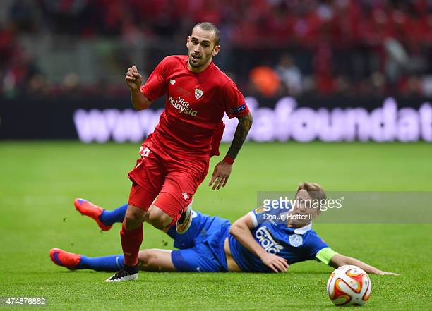 Aleix Vidal of Sevilla is challenged by Ruslan Rotan of Dnipro during the UEFA Europa League Final match between FC Dnipro Dnipropetrovsk and FC...