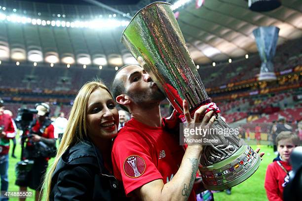 Aleix Vidal of Sevilla kisses the trophy as he celebrates victory after the UEFA Europa League Final match between FC Dnipro Dnipropetrovsk and FC...