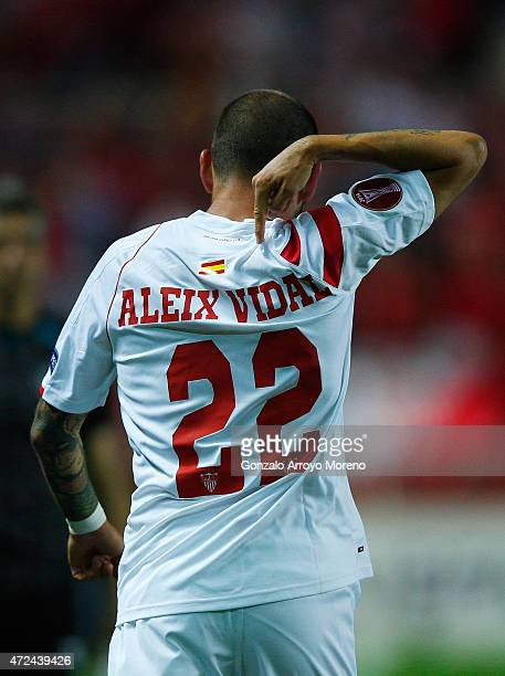 Aleix Vidal of Sevilla points to his name as he celebrates scoring his second goal during the UEFA Europa League Semi Final first leg match between...