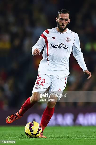 Aleix Vidal Parreu of Sevilla FC runs with the ball during the La Liga mach between FC Barcelona and Sevilla FC at Camp Nou on November 22 2014 in...