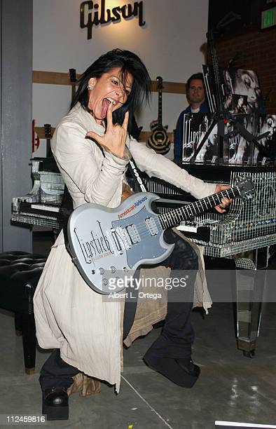 Alejandra Guzman with her customized Gibson SG during Press Conference to Announce Alejandra Guzman's New CD 'Lipstick' at Gibson Guitar Showroom in...