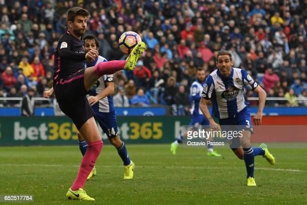 Alejandro Arribas of RC Deportivo La Coruna competes for the ball with Gerard Pique of FC Barcelona during the La Liga match between RC Deportivo La...