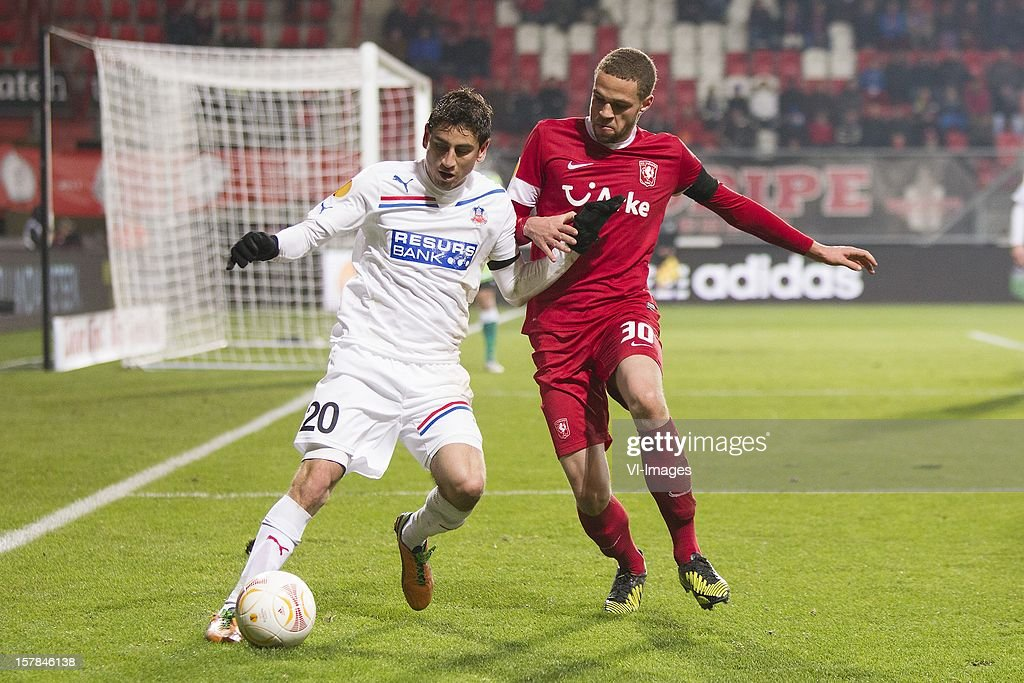 Alejandro Bedoya of Helsingborgs IF, Luc Castaignos of FC Twente during the Europa League match between FC Twente and Helsingborgs IF at the Grolsch Veste on December 6, 2012 in Enschede, The Netherlands.