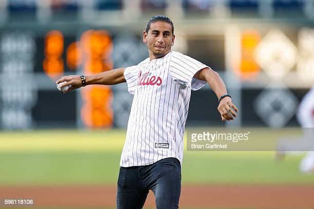 Alejandro Bedoya of the Philadelphia Union throws the ceremonial first pitch of the game between the Los Angeles Dodgers and the Philadelphia...
