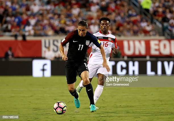 Alejandro Bedoya of the United States drives past Levi Garcia of Trinidad and Tabago during the FIFA 2018 World Cup Qualifier at EverBank Field on...