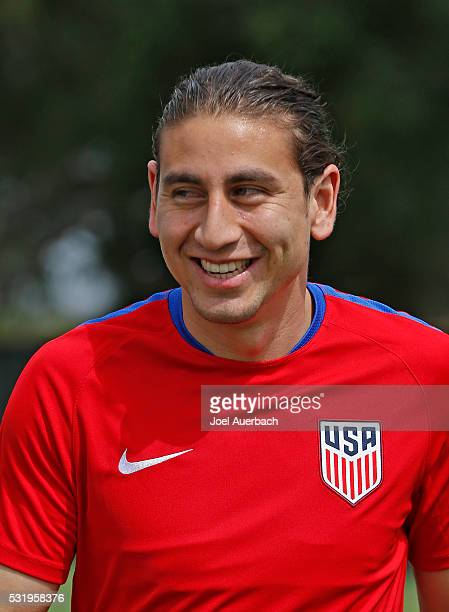 Alejandro Bedoya of the US Men's National team walks to the media to answer questions prior to a training session on May 17 2016 at Buccaneer Field...