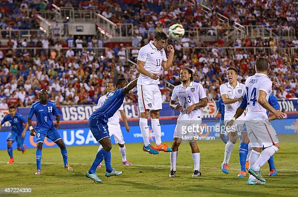Alejandro Bedoya of the USA goes up for a header during a game against Honduras at FAU Stadium on October 14 2014 in Boca Raton Florida