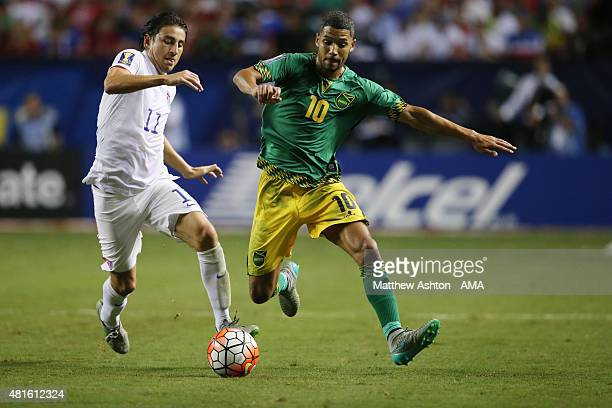 Alejandro Bedoya of United States of America and Joel McAnuff of Jamaica battle for the ball during the 2015 CONCACAF Gold Cup Semifinal between USA...