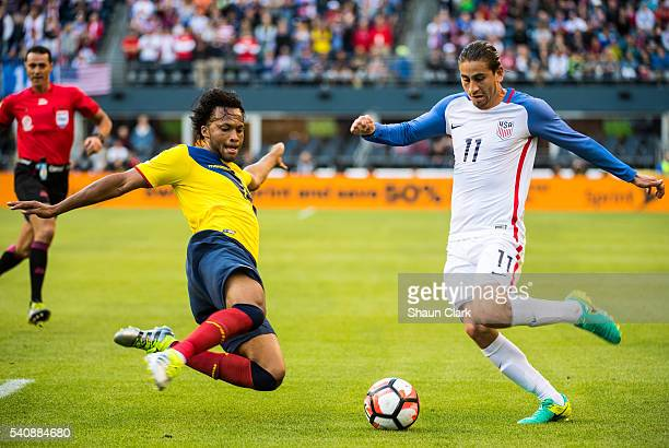 Alejandro Bedoya of United States races forward as Arturo Mina of Ecuador defends during the Copa America Centenario Quarterfinal match between...