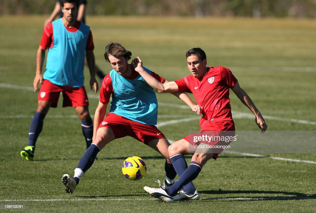 Alejandro Bedoya puts a shot on goal as Mix Diskerud tries to defend the play during the U.S. Men's Soccer Team training session at the Home Depot Center on January 17, 2013 in Carson, California.