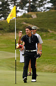 Alejandro Canizares of Spain celebrates a holeinone at the 13th hole on the Old Course during The Open Championship International Final Qualifying at...