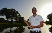 Alejandro Canizares of Spain holds the winners trophy after the final round of the Trophee Hassan II Golf at Golf du Palais Royal on March 16 2014 in...