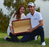 Alejandro Canizares of Spain holds the winners trophy with his girlfriend Ingrid after the final round of the Trophee Hassan II Golf at Golf du...