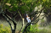Alejandro Canizares of Spain in trouble for his third shot on the 9th hole during the first round of the 2011 Omega Dubai Desert Classic on the...