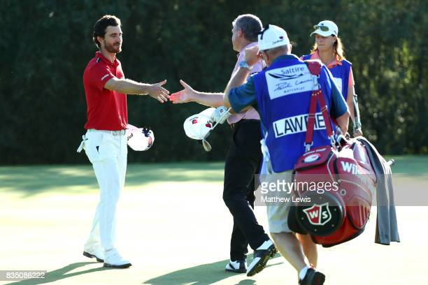 Alejandro Canizares of Spain is is congratulated by Paul Lawrie of Scotland on his win on the 17th green during the 32 qualifiers matches of the...