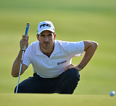 Alejandro Canizares of Spain lines up a putt during the first round of the Trophee du Hassan II Golf at Golf du Palais Royal on March 13 2014 in...