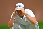 Alejandro Canizares of Spain lines up a putt during the third round of the Trophee Hassan II Golf at Golf du Palais Royal on March 15 2014 in Agadir...