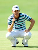 Alejandro Canizares of Spain lines up his putt on the 18th hole during the playoff against Peter Hanson of Sweden during the final round of the Open...