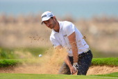 Alejandro Canizares of Spain plays a bunker shot during the final round of the Trophee Hassan II Golf at Golf du Palais Royal on March 16 2014 in...