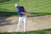 Alejandro Canizares of Spain plays from a bunker on the 15th hole during round four of the Abu Dhabi HSBC Golf Championship at the Abu Dhabi Golf...
