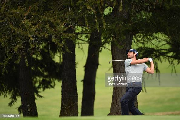 Alejandro Canizares of Spain plays his second shot on the 12th hole during the final round of the Omega European Masters at CranssurSierre Golf Club...